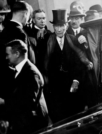 John D. Rockefeller, Sr. and his son John, Jr. leave a weddi
